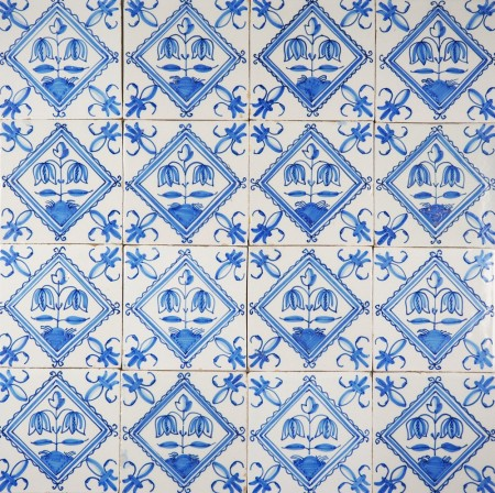 Antique Delft wall tiles in blue with flowers in a diamond square, 19th century