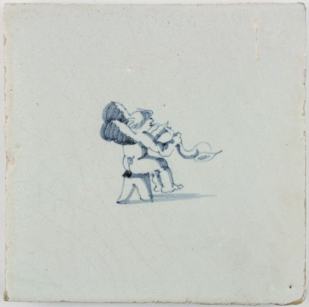 Antique Delft tile in blue with Cupid playing the horn, 17th century