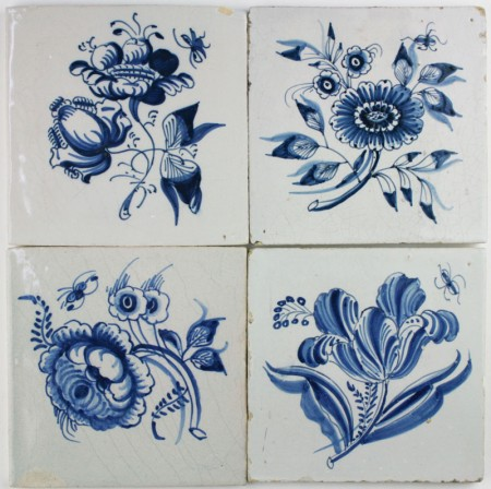 Antique Dutch Delft wall tiles with large flowers in blue
