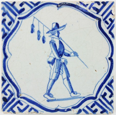 Antique Dutch Delft tile in blue and Wanli with a Rat-Catcher, 17th century