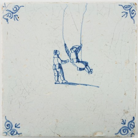 Antique Dutch Delft tile with two children playing on a swing, 17th century