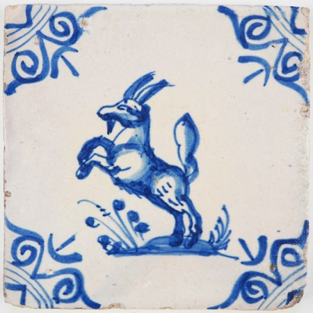 Antique Delft tile with a beautiful and fierce looking capricorn in blue, 17th century