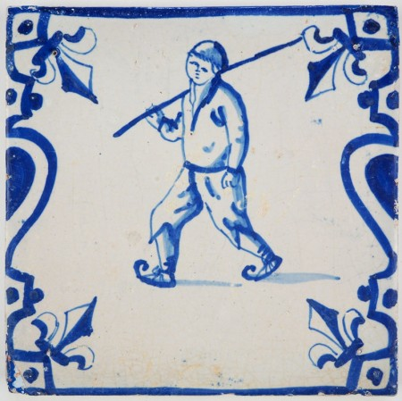 Antique Dutch Delft tile with balusters at the side and a beautiful ice skater, 17th century