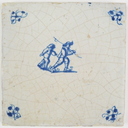 Antique Delft tile in blue with two figures skating on ice, 17th century