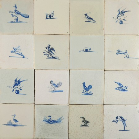 Antique Delft wall tiles in blue with small scenes depicting animals, 17th century