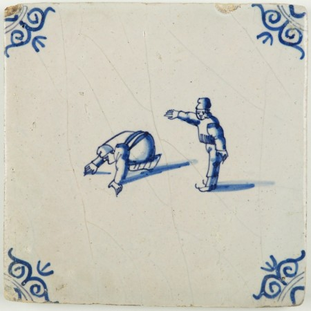 Antique Dutch Delft tile in blue with two figures skating on ice, 17th century