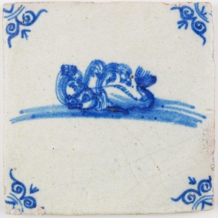 Antique Dutch Delft tile in blue with a whale expelling air, 17th century