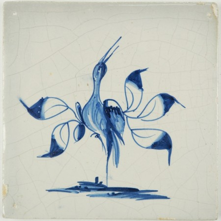 Antique Delft tile with a beautiful stylized bird in blue with leaves as wings, 18th century