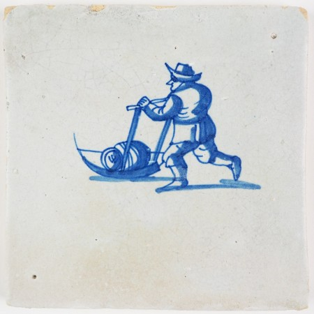 Antique Delft tile with a man skating behind a sledge with a barrel, 17th century winter scene