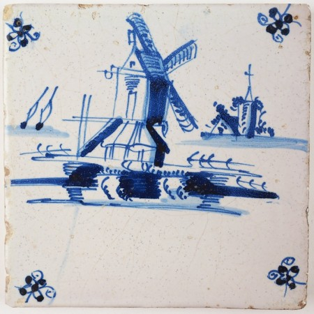 Antique Delft tile in blue with a post mill in a Dutch landscape, 18th century