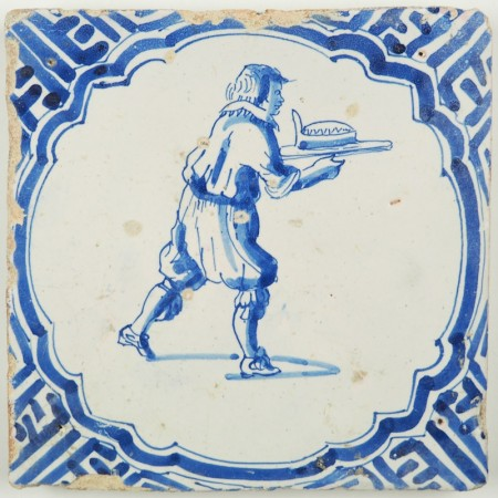 Antique Dutch Delft tile with a servant serving a meal on a plate, 17th century