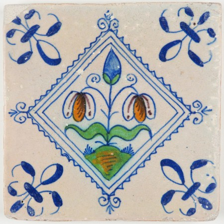 Antique Delft tile with polychrome flowers in a diamond square, 17th century
