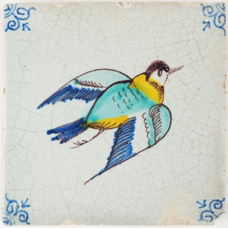 Antique Delft tile depicting a polychrome bird in full flight, 17th century