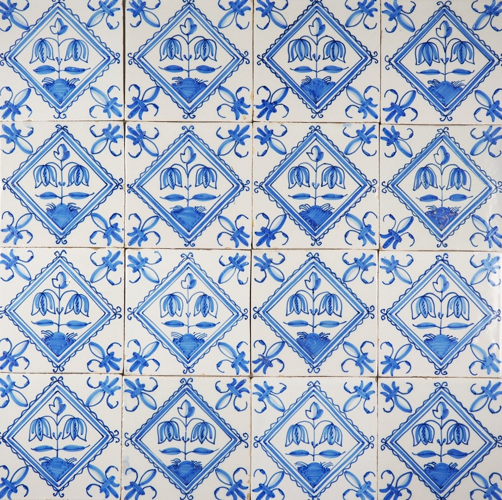 Antique Delft wall tiles in blue with flowers in a diamond square ...