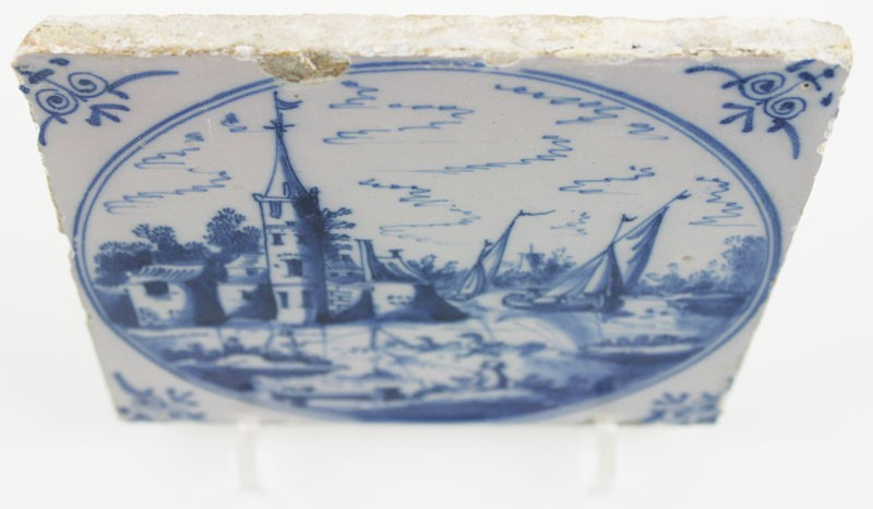Antique Dutch Delft Landscape Tile In Blue With Boats A Village And Men Fishing 18th