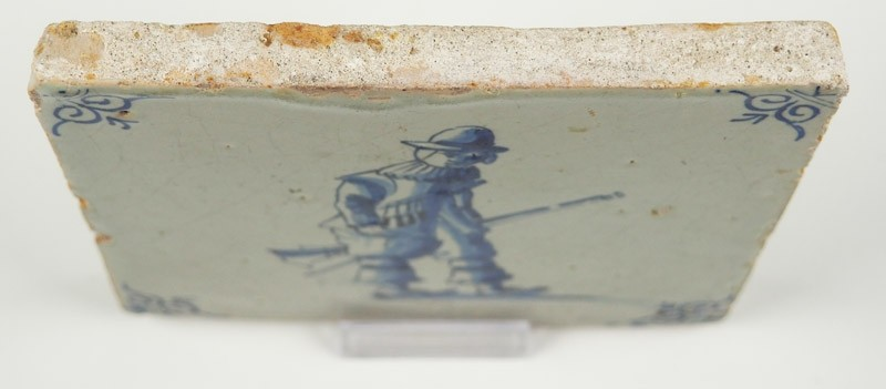 Antique Delft Tile In Blue With A Soldier Carrying His Rifle 17th