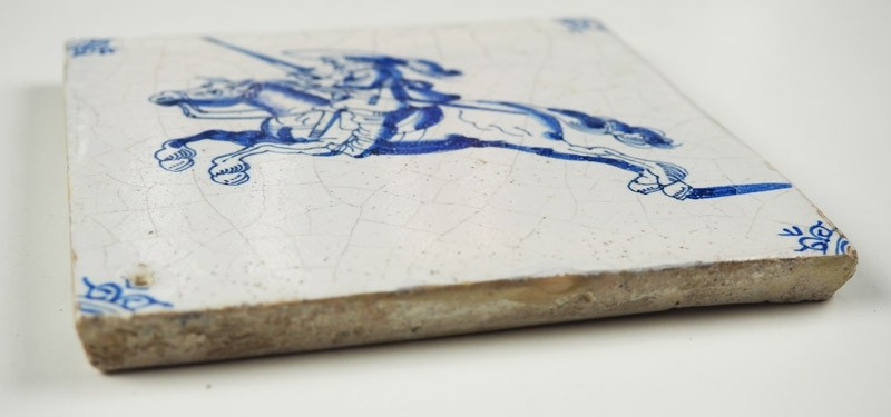 Antique Delft Tile With A Soldier Wielding A Sword While