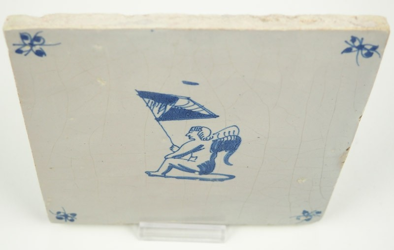 Antique Delft Tile With Cupid Sitting While Holding A Flag Late 17th