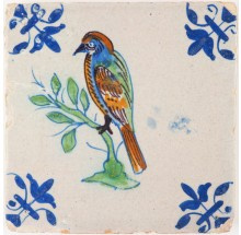 Antique Delft tile with a polychrome bird and 'lily' corner motifs, 17th century