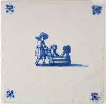 Antique Delft tile with a father skating behind a sledge carrying his children, 18th century