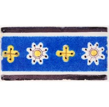 Antique Delft tile border in blue, yellow and manganese with a cross inspired pattern, 19th century