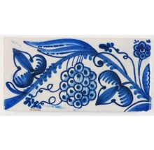 Antique Delft border tile with grapes in blue, 19th century