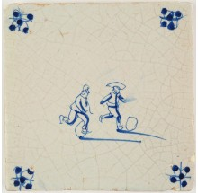 Antique Delft tile in blue with two children playing with hoops, 17th century
