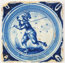 Antique Delft circle cord tile in blue with a hunter blowing the horn, 17th century