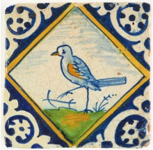 Antique Delft polychrome diamond square kwadraat tile with a bird, 17th century