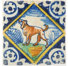 Antique Delft polychrome diamond square tile with a barking dog, early 17th century