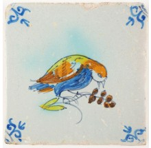 Antique Delft tile with a poychrome bird eating cherries, 17th century