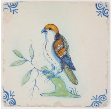 Antique Delft polychrome tile with a bird of prey, 17th century