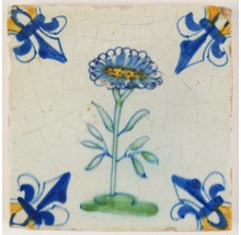 Antique Delft polychrome tile with a Daisy flower, 17th century Gouda