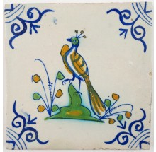Antique Delft polychrome tile with a confident looking peacock, 17th century