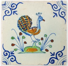 Antique Delft tile with a polychrome peacock, 17th century