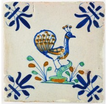 Antique Delft polychrome tile with a peacock facing to the right, 17th century