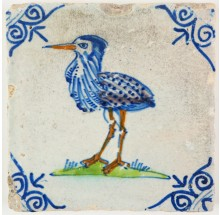 Antique Delft tile with a polychrome bird the Eurasian bittern, 17th century