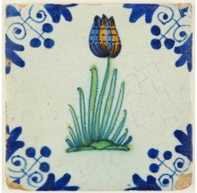 Antique Delft tile with a polychrome tulip, 17th century