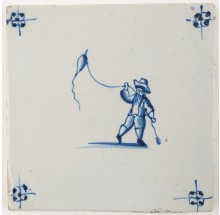 Antique Delft tile in blue with a child flying a kite, 19th century