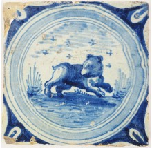 Antique Delft tile in blue with a bear in a circle cord border, late 16th or early 17th century