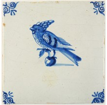 Antique Delft tile in blue with a bird near a piece of fruit, 17th century