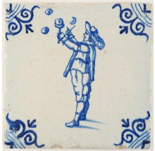 Antique Delft tile in blue with a boy blowing bubbles, 17th century