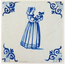Antique Delft tile in blue with a girl playing with a miniature windmill, 17th century