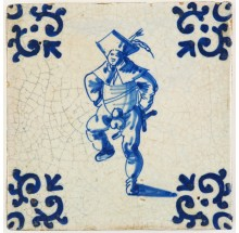 Antique Delft tile in blue with a man dancing enthusiastically, 17th century