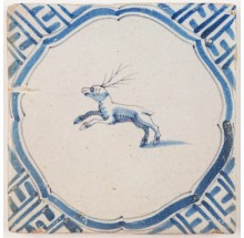 Antique Delft tile in blue with a deer surrounded by a Wanli inspired corner motif, 17th century