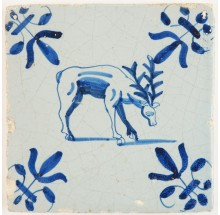 Antique Delft tile in blue with a deer with large antlers grazing in the grass, 17th century