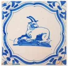 Antique Delft tile in blue with a billy goat resting, 17th century