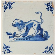 Antique Delft tile with a fierce looking lion in blue, 17th century