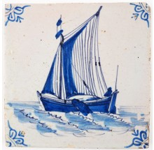 Antique Delft tile in blue with a large carge boat under sail, 17th century Harlingen