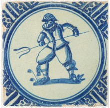 Antique Dutch Delft tile depicting a farmer or fisherman with an eel spear, 17th century